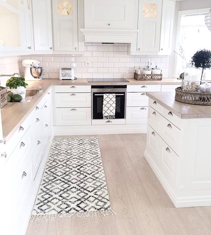 White Kitchen Cabinets Light Floor: Vintage Modern Kitchen Idea