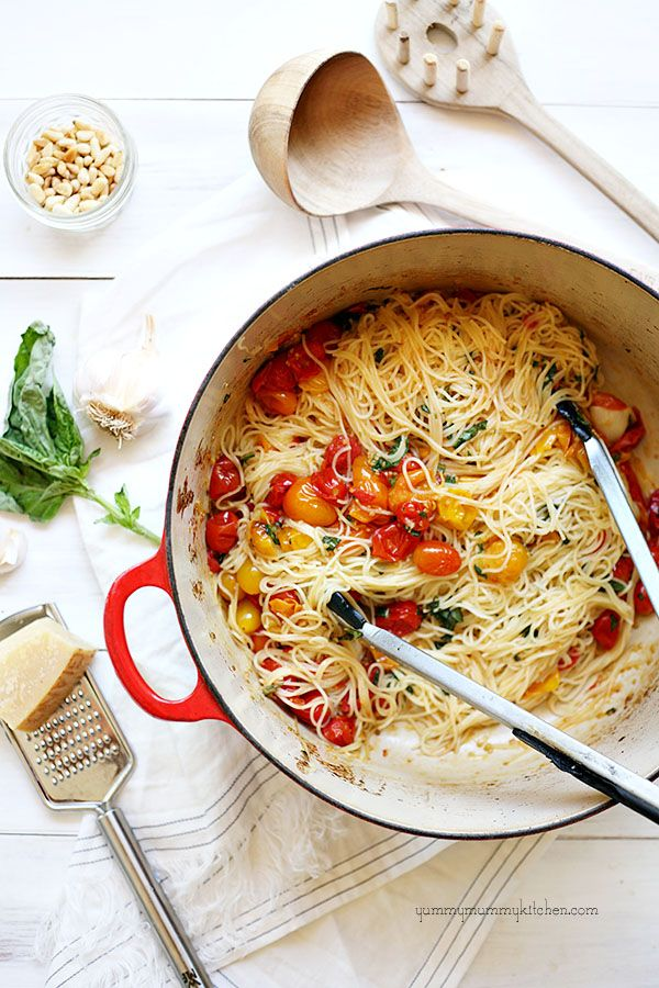 Angel hair pasta, roasted garlic and cherry tomatoes. add some sautéed spinach.. mmm yes.