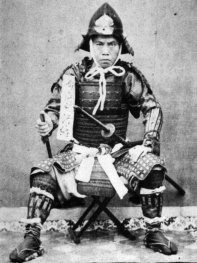 Samurai wearing full armor with a sode-jirushi on his ...
