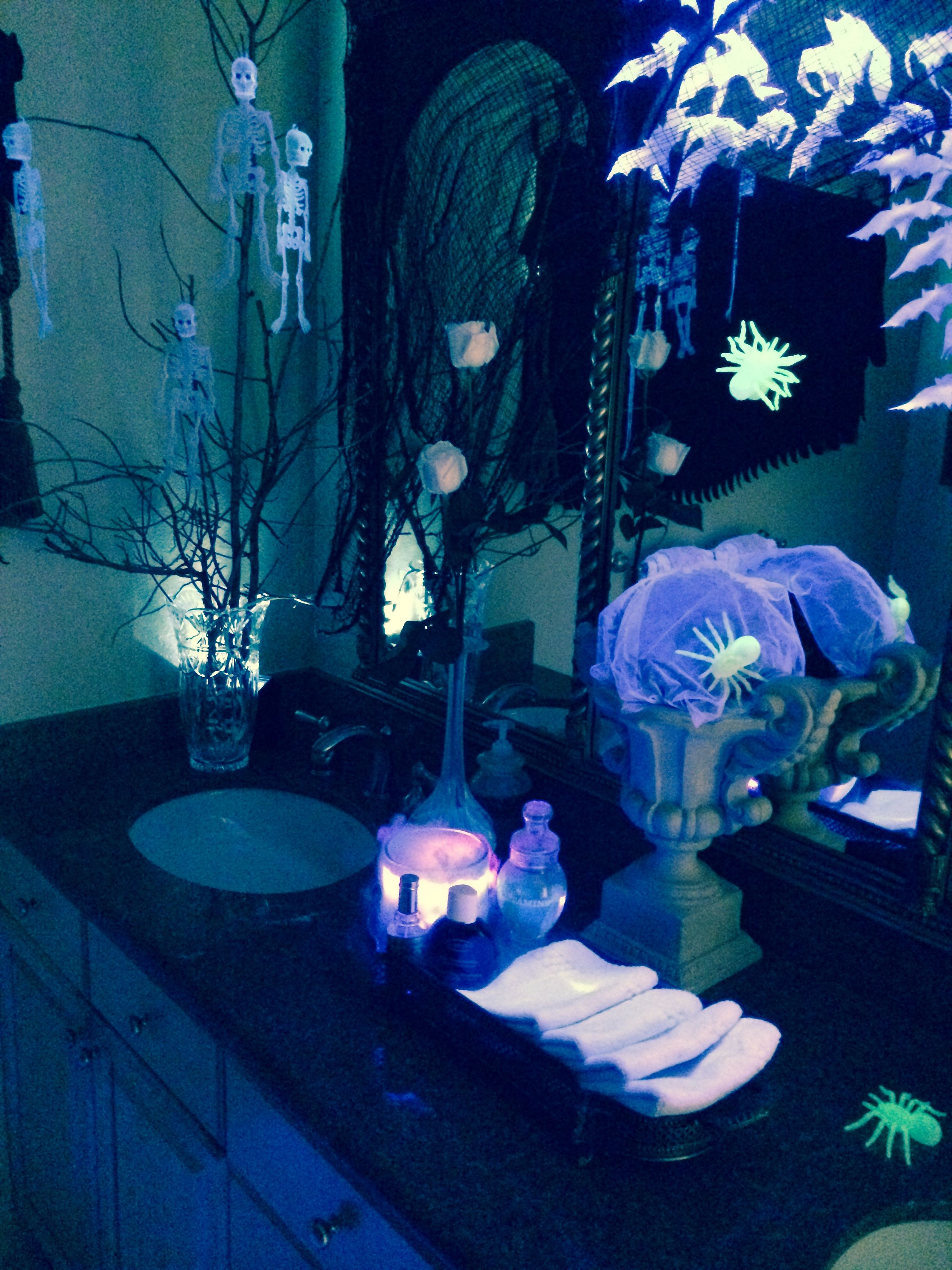 halloween bathroom decorations! blacklight + white bats + dry ice in