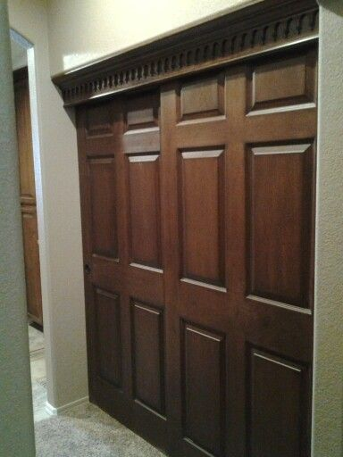 White hollow core, 6 panel doors finished to look like rustic wood doors to match above detail.