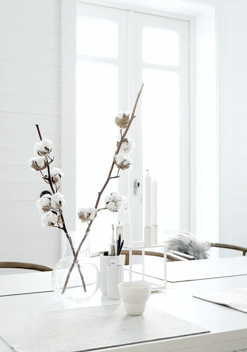 white dog #dog Modern simplicity. White cotton blooms and nondescript vases brighten up a classic all-white decor scheme.
