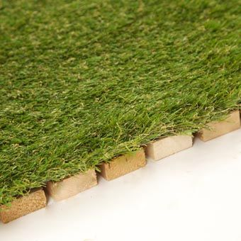 outdoor deck turf tile showing edge of tile my tiny house