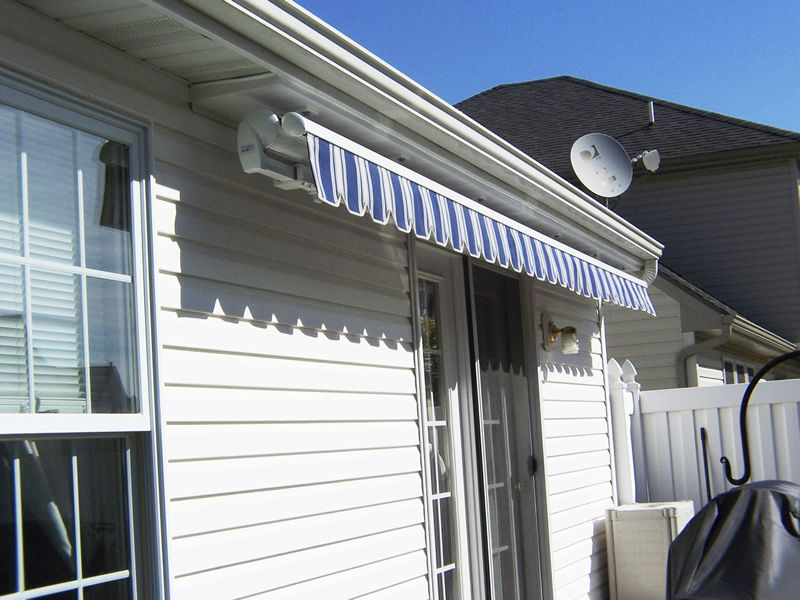 Retractable blue Estate awning in an under soffit mount ...