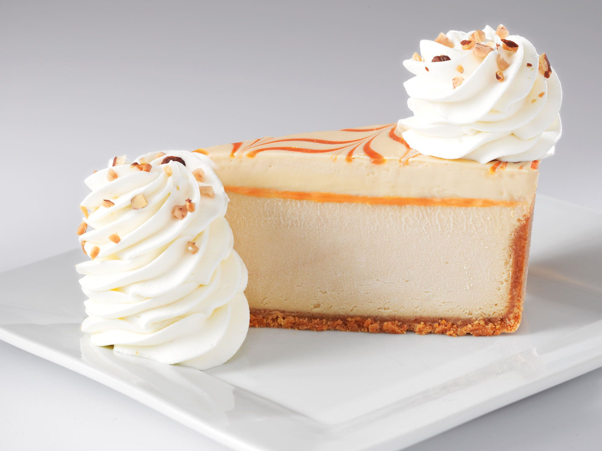 Dulce de Leche Caramel Cheesecake caramel cheesecake topped with caramel mousse on a vanilla crust