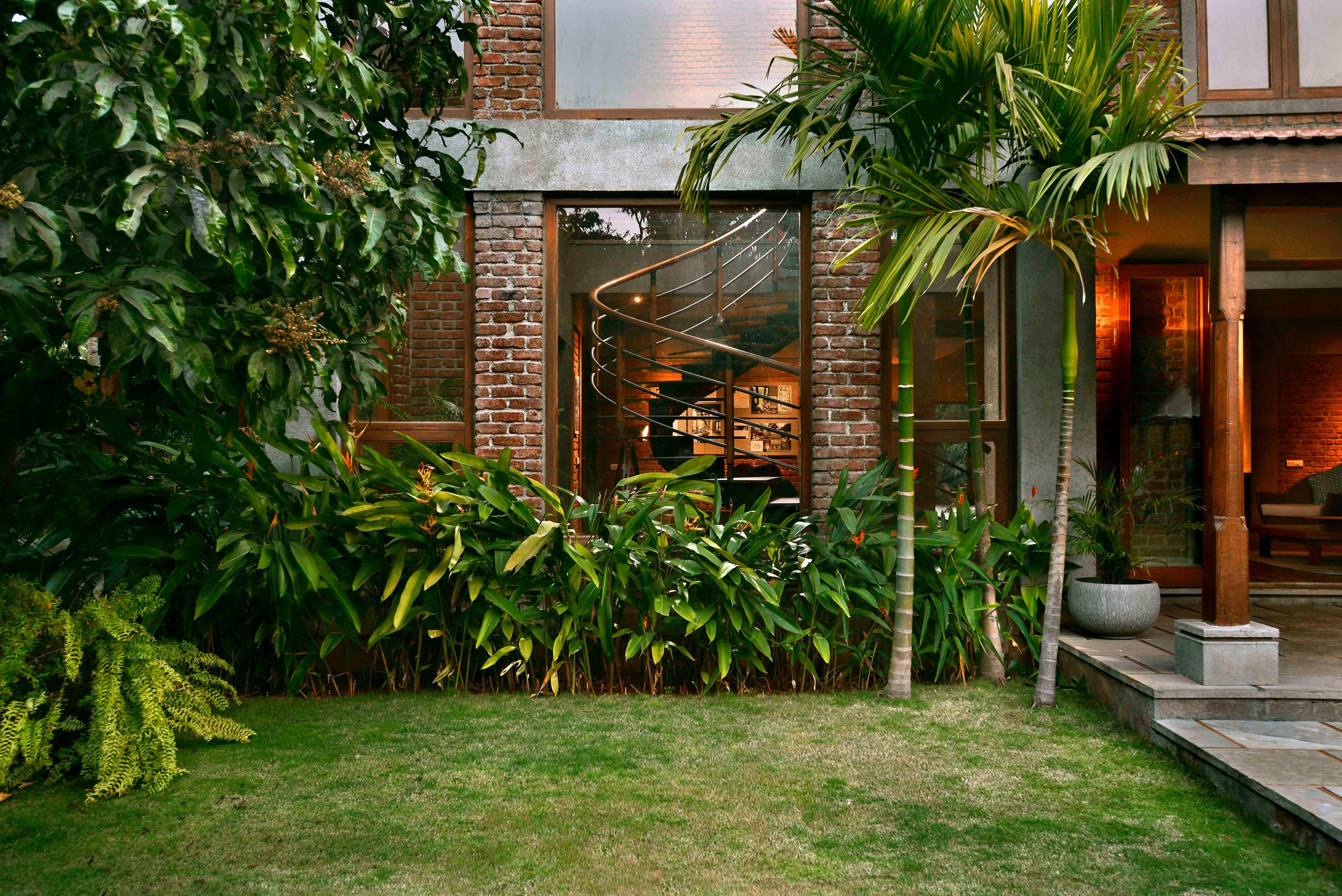Brick-lined interiors open up to garden filled with fruit