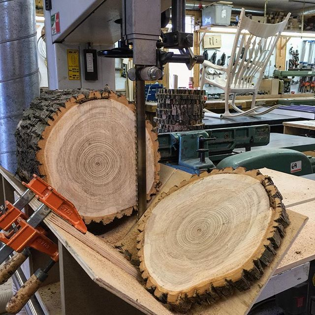 Wood cookies being sliced at the band saw using a simple sled to accurately…