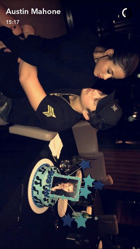 Austin Mahone being helped by a young lady.