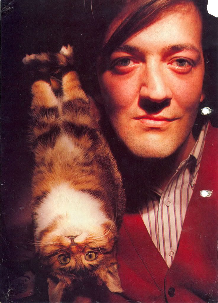 Stephen Fry / Born:   Stephen John Fry  August 24, 1957 in Hampstead, London, England, UK / with cat who seems to have seen it all