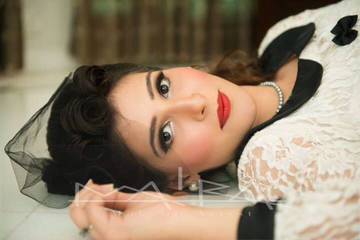 Vintage look Matte Red lip, bold thick eyeliner, silver pop to inner corner and strong pink blush
