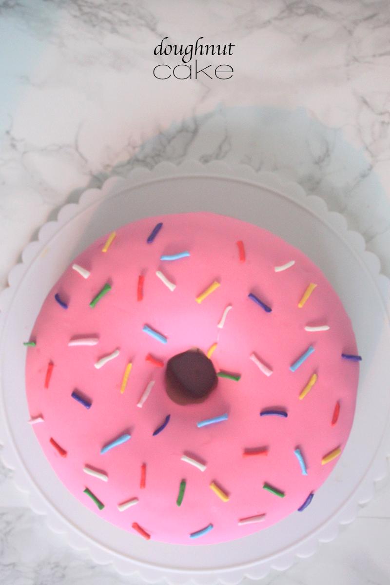Doughnut Cake | Doughnut cake, Doughnuts and Sprinkles