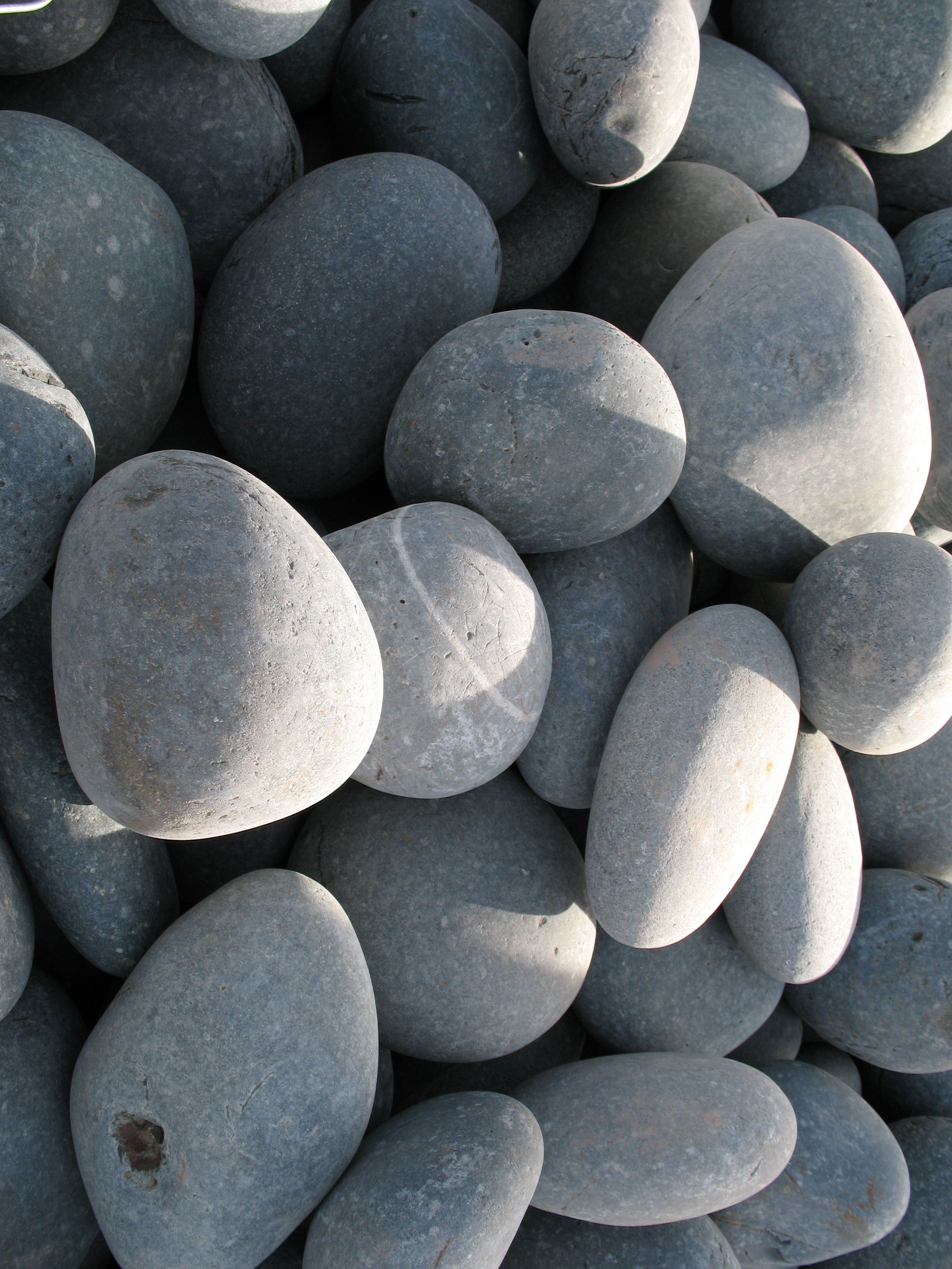 Mexican beach pebbles for Smooth stones for landscaping