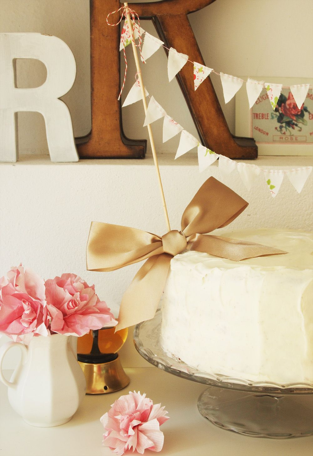 Creative miniature bunting cake toppers you can do yourself bunting cake topper with bow who says wedding cakes have to be expensive make kente bunting for a colorful cake solutioingenieria Choice Image