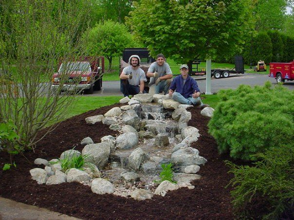 Pondless waterfall pondless waterfall backyard for Front yard pond ideas