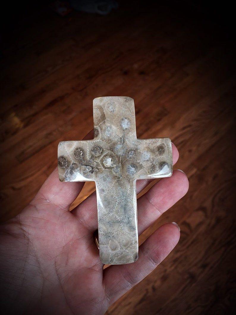 Beautifully hand polished cross shaped petoskey stone