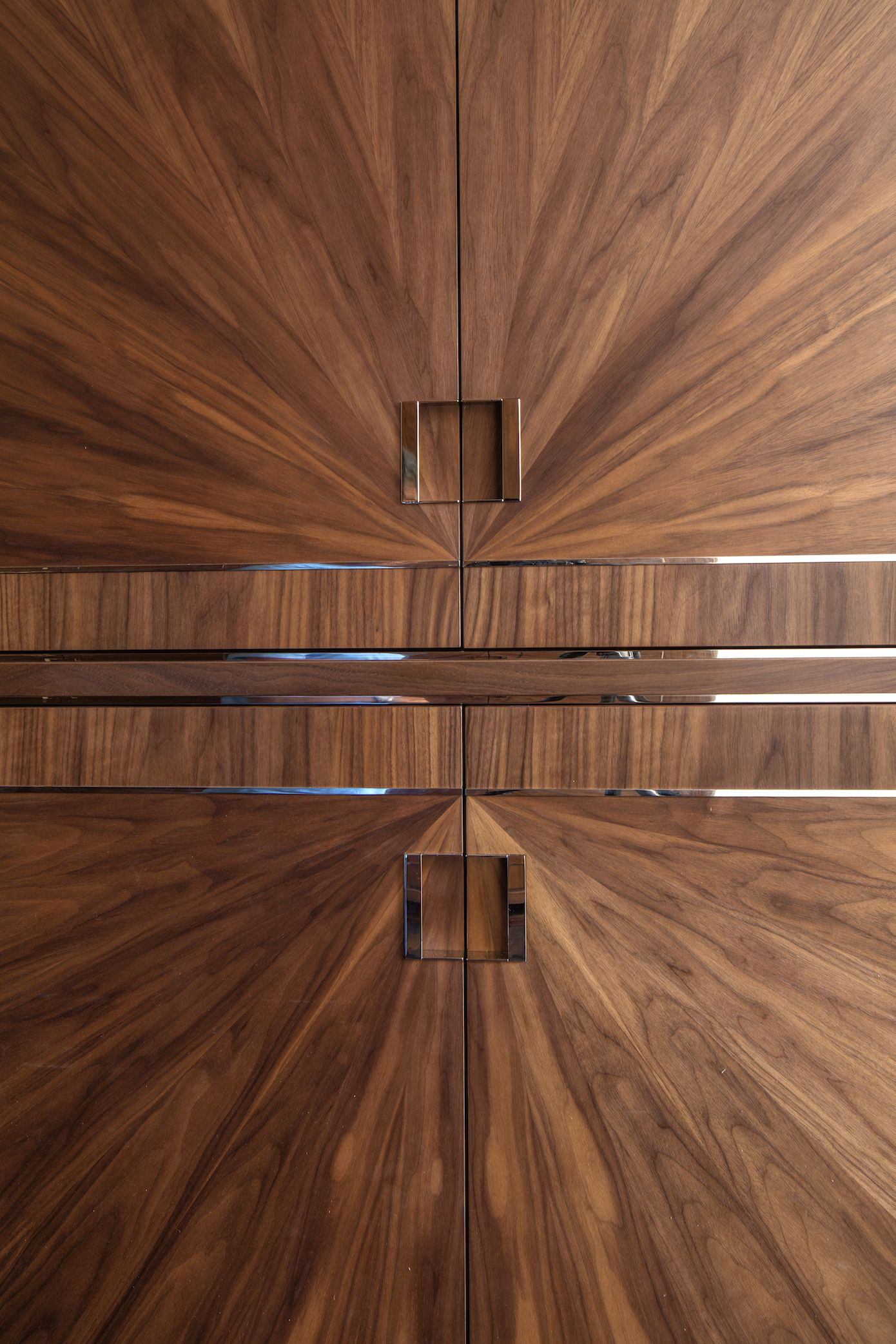 Wardrobe Detail Showing Hand Veneered Walnut Starbust And Polished Nickel Inlays
