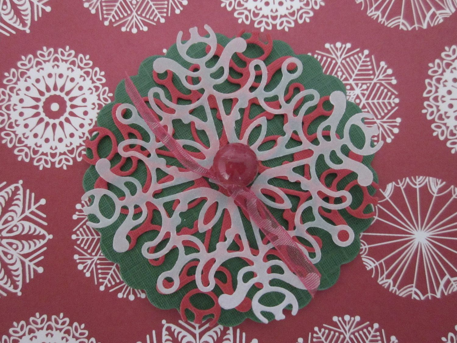 Paper lace flower wall art in Christmas green and red