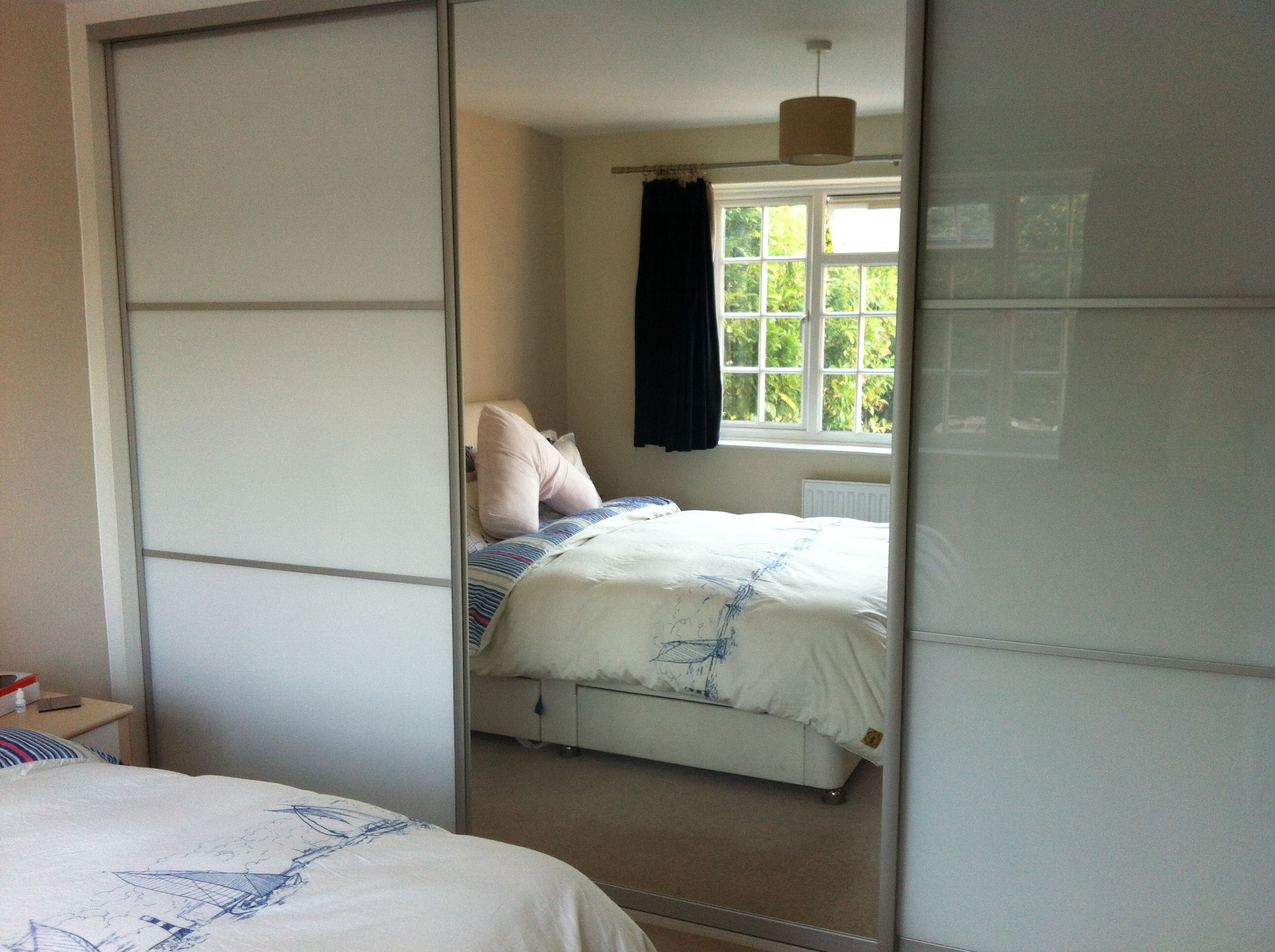 custom made sliding wardrobe system in surrey with silver