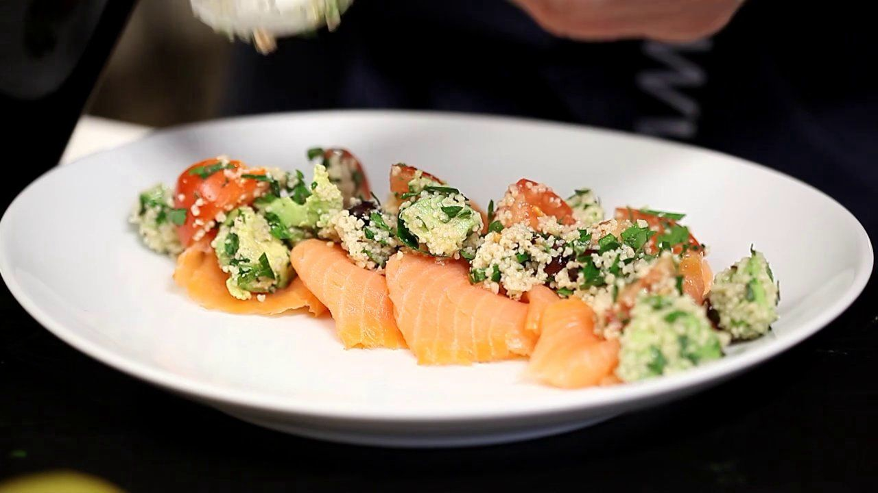 Photo of Smoked salmon and couscous salad with avocado, tomatoes and olives