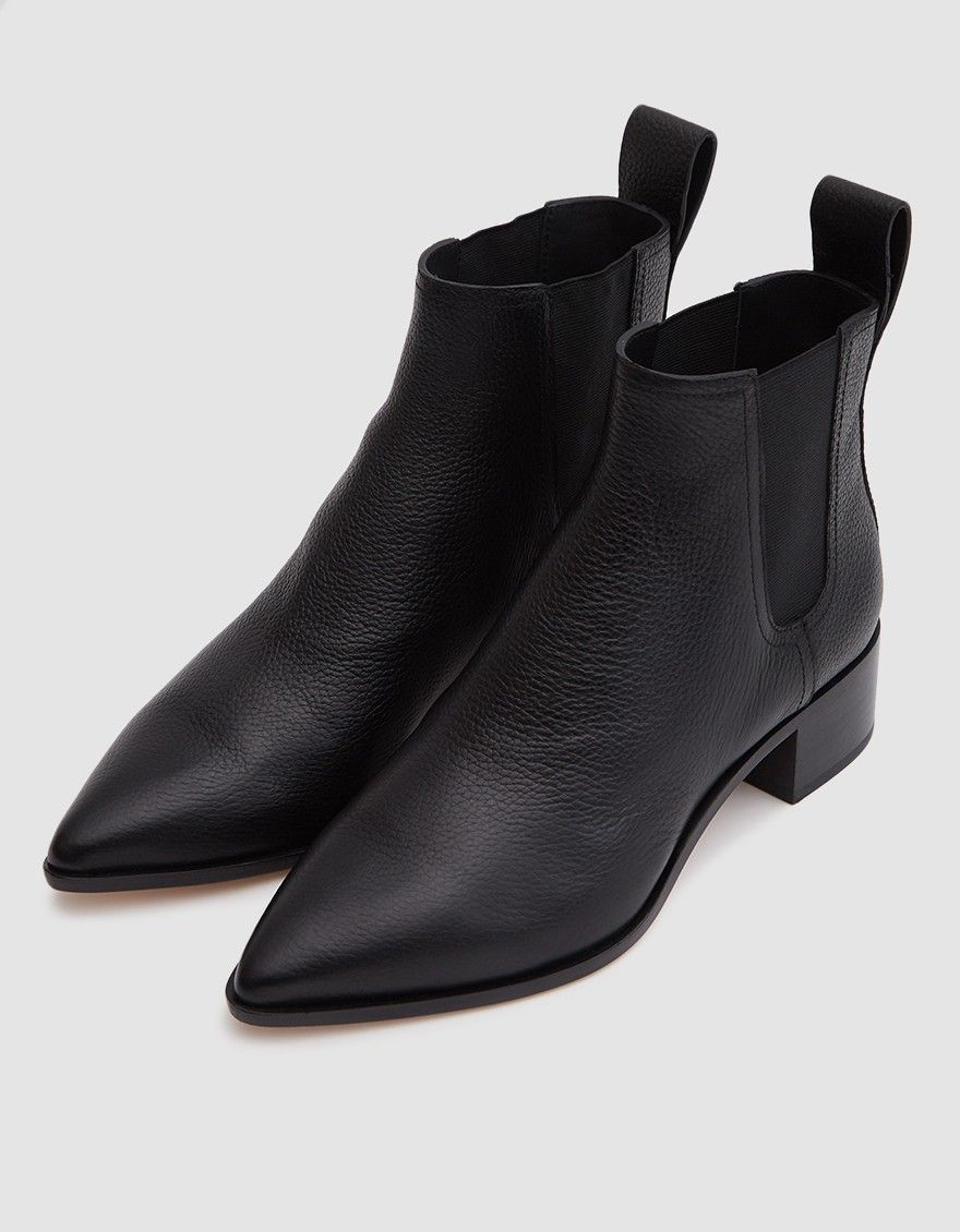 bec218a6e71c4 Feminine chelsea boot from Loeffler Randall in Black. Tumbled leather  upper. Pointed toe. Elastic goring at sides. Wide pull tab. Lightly padded  footbed.
