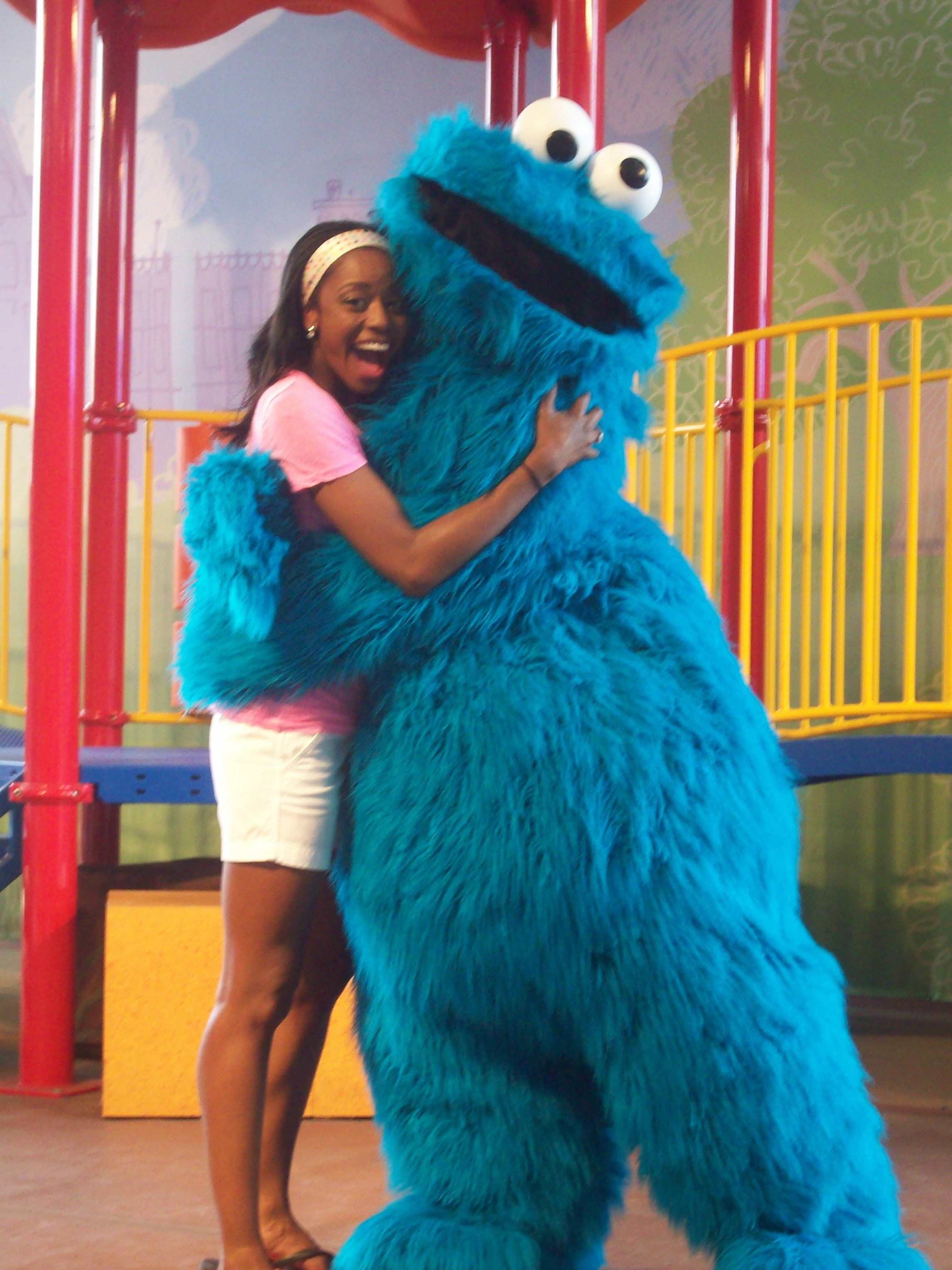 Melissa enjoying some love from Cookie Monster at Sesame Place, one ...