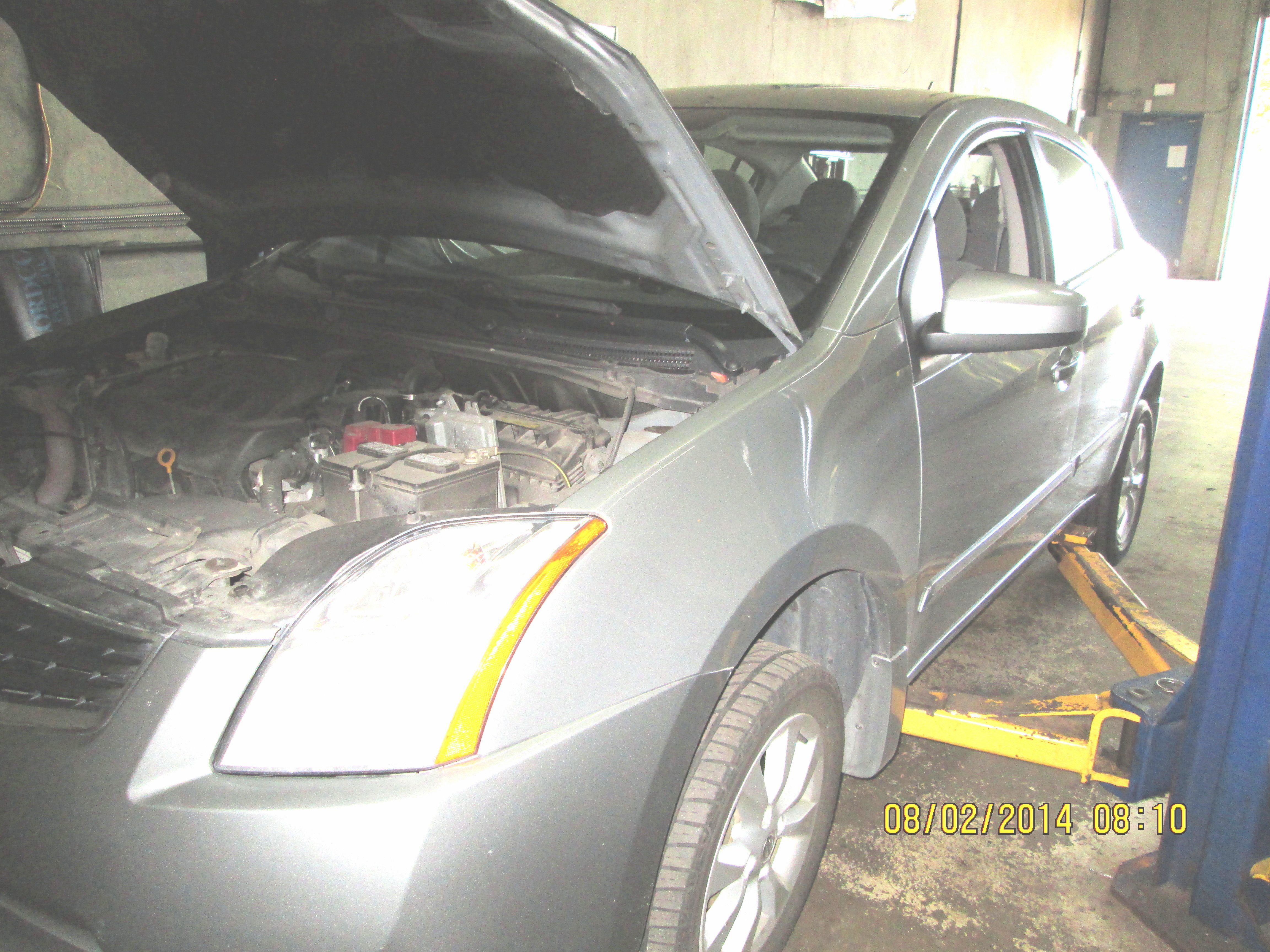 2010 Nissan Sentra in for lubrication and oil change service