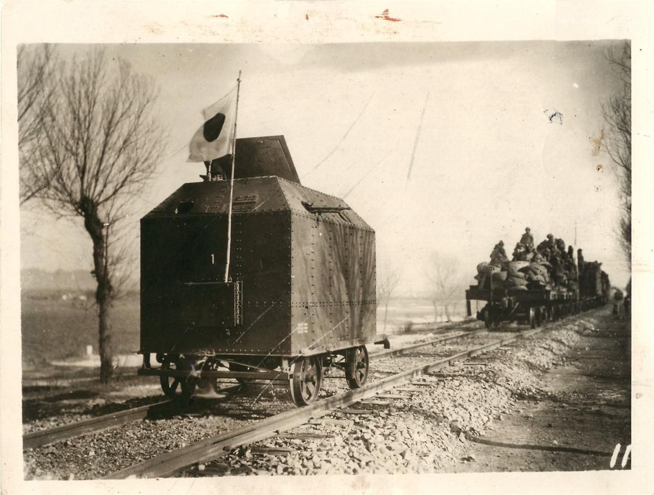 1932 Japanese armored train car seen following troops and