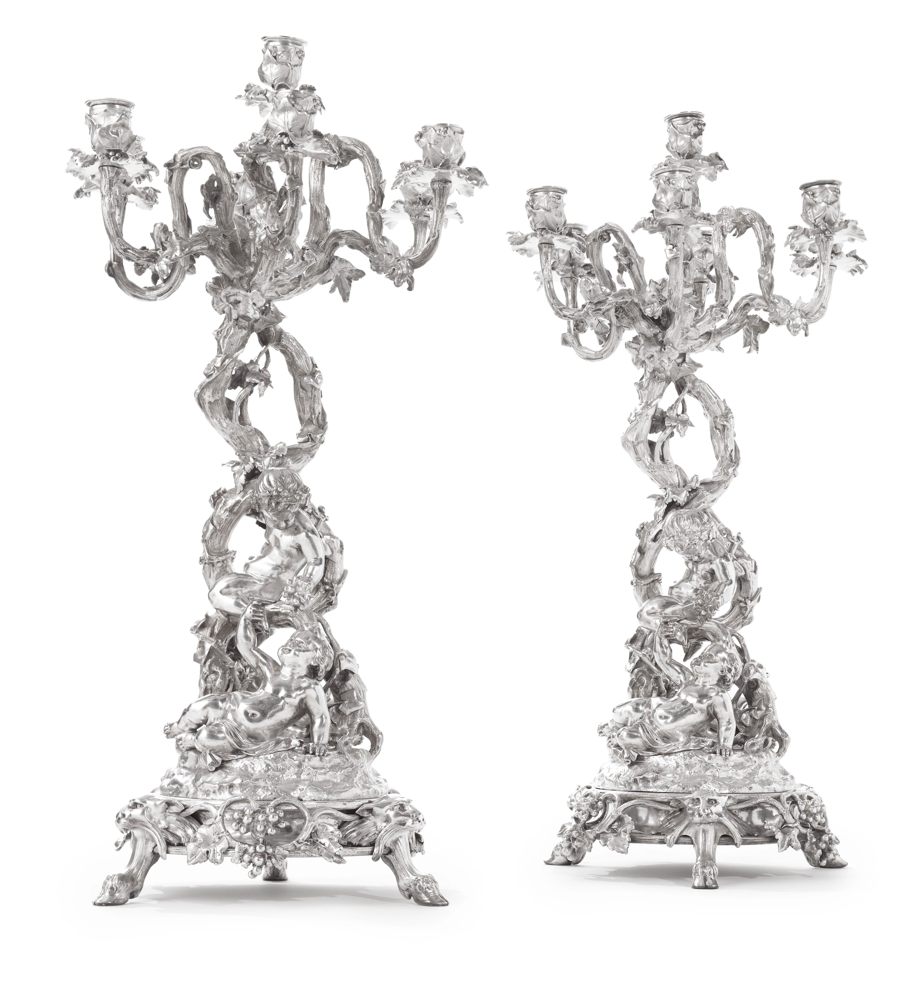 A Pair Of Napoleon Iii Silver Plated Seven Light Figural