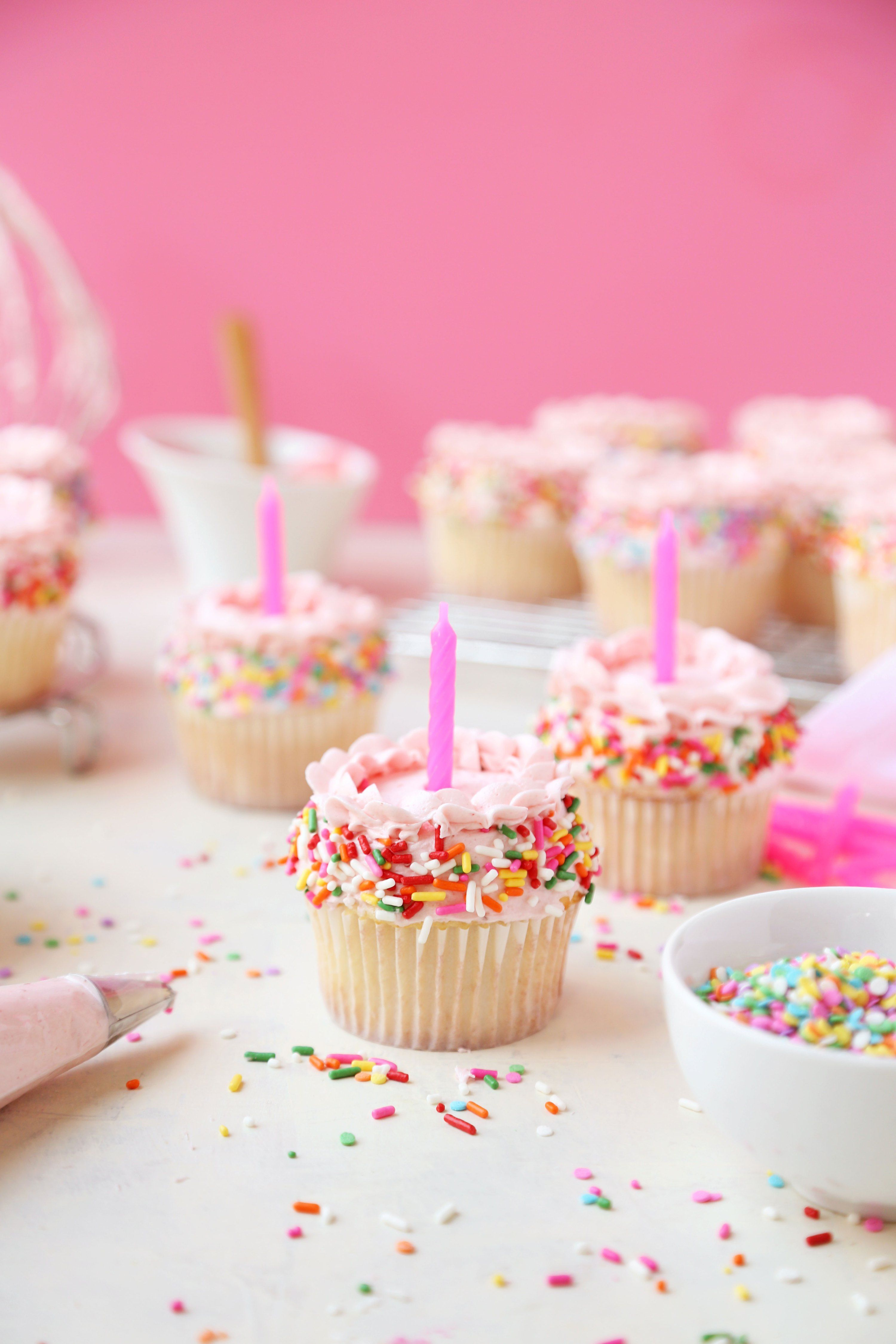 Vanilla Birthday Sprinkle Cupcakes are the perfect treat for any birthday, or any day of the week. Vanilla cake with a strawberry buttercream frosting.