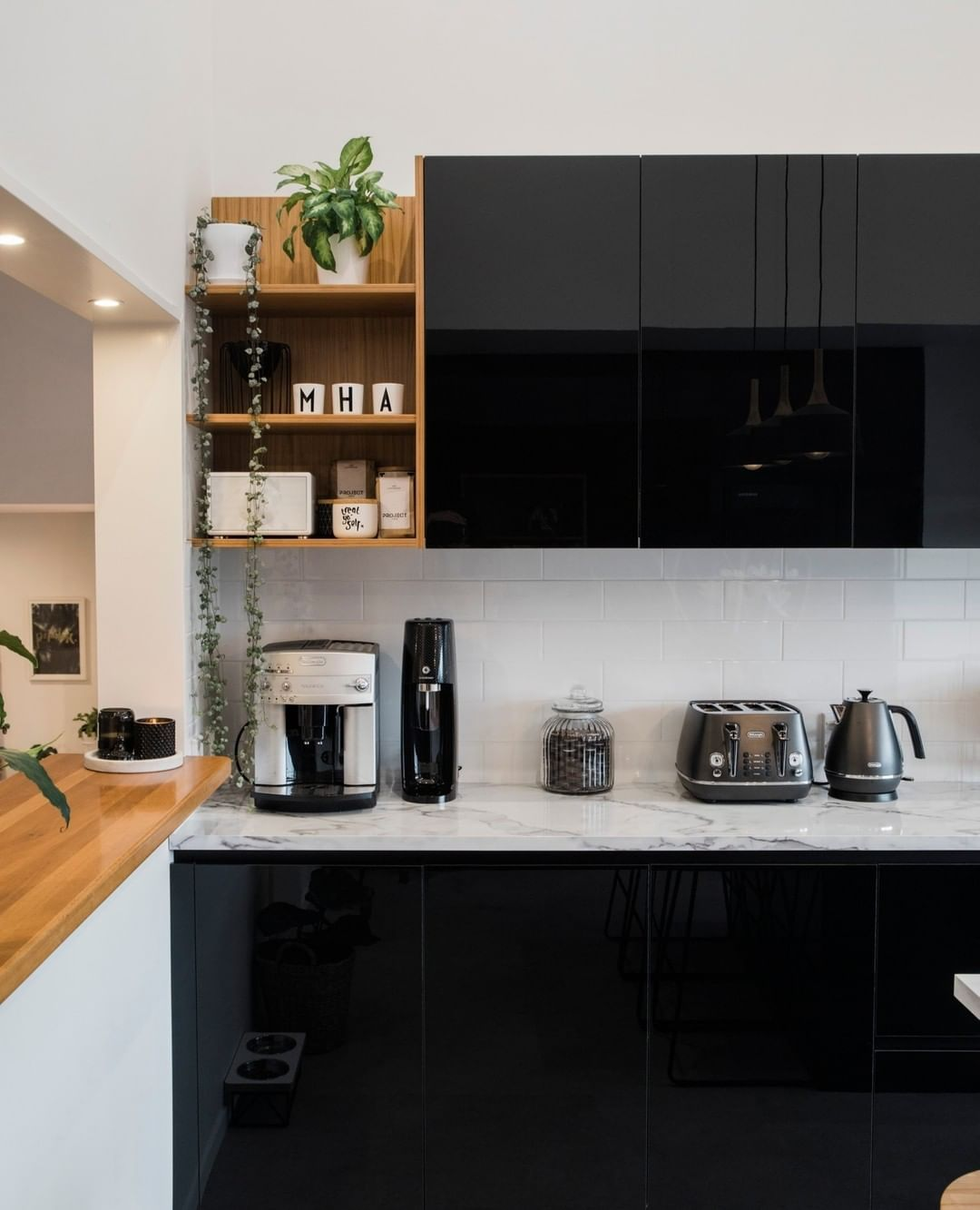 Your Home And Garden On Instagram Making A Case For Glossy Black Kitchen Cabinets Photo Modern Kitchen Interiors Black Kitchens Black Kitchen Cabinets