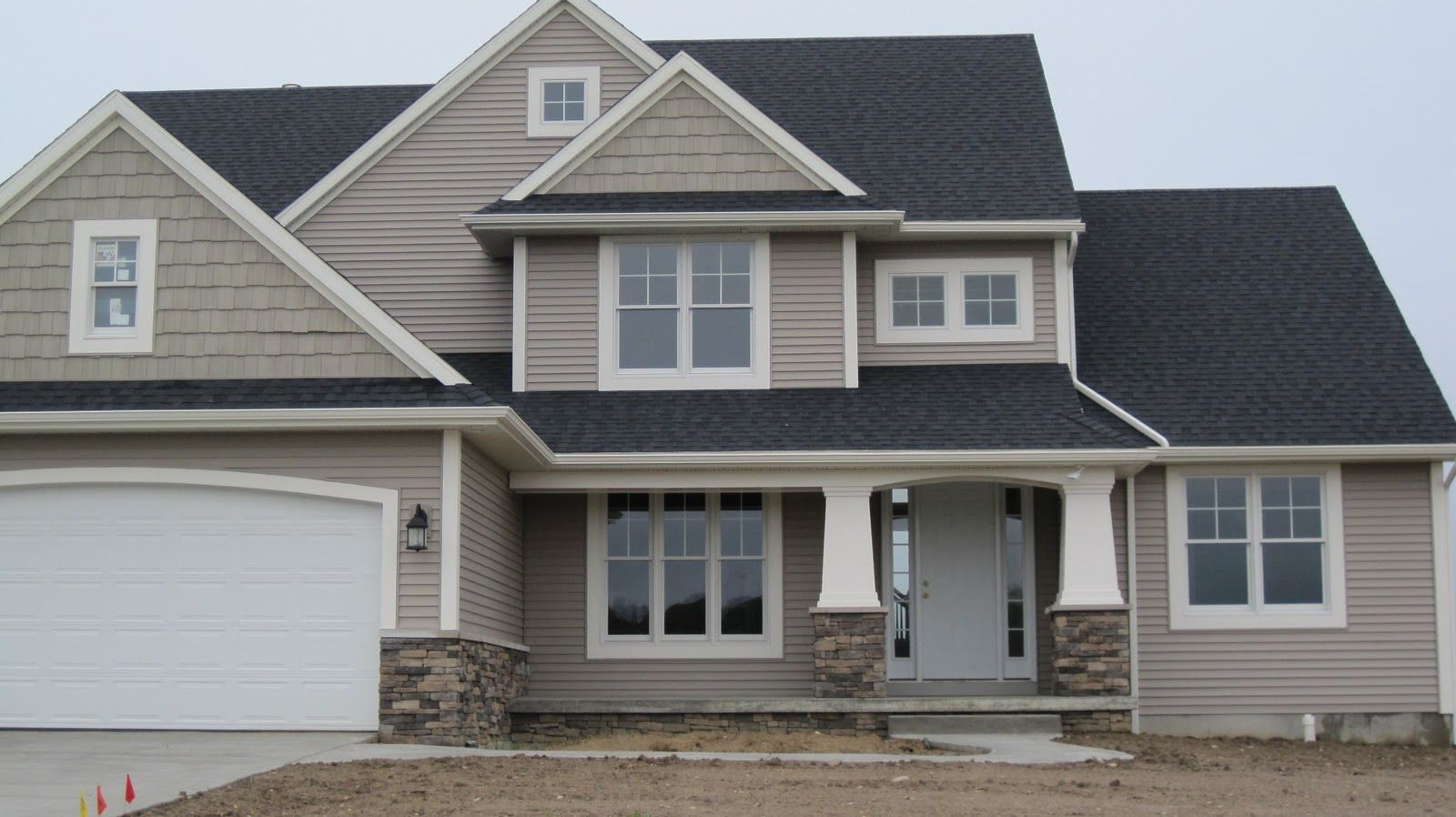 craftsman with stone pillars | to us in a subdivision. This house seems dabble in the Craftsman ...