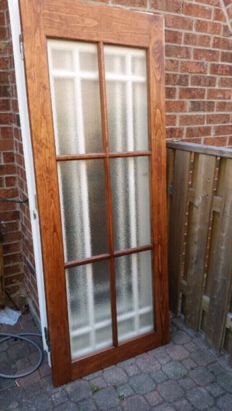 selling a solid wood door that is stained with a privacy glass that ...