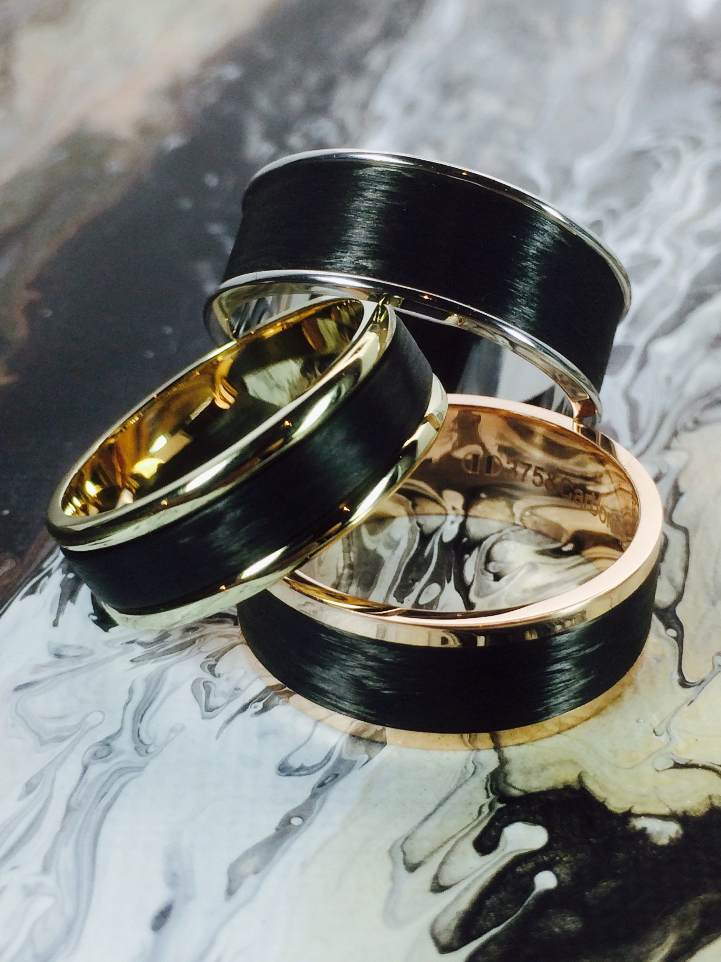 Black rings. Dora Carbon Fibre and gold rings. Available