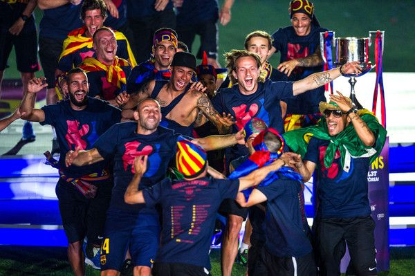 FC Barcelona players celebrate with La Liga, Copa del Rey and Champions League trophies during their victory parade after winning the UEFA Champions League Final at the Camp Nou Stadium on June 7, 2015 in Barcelona, Catalonia.