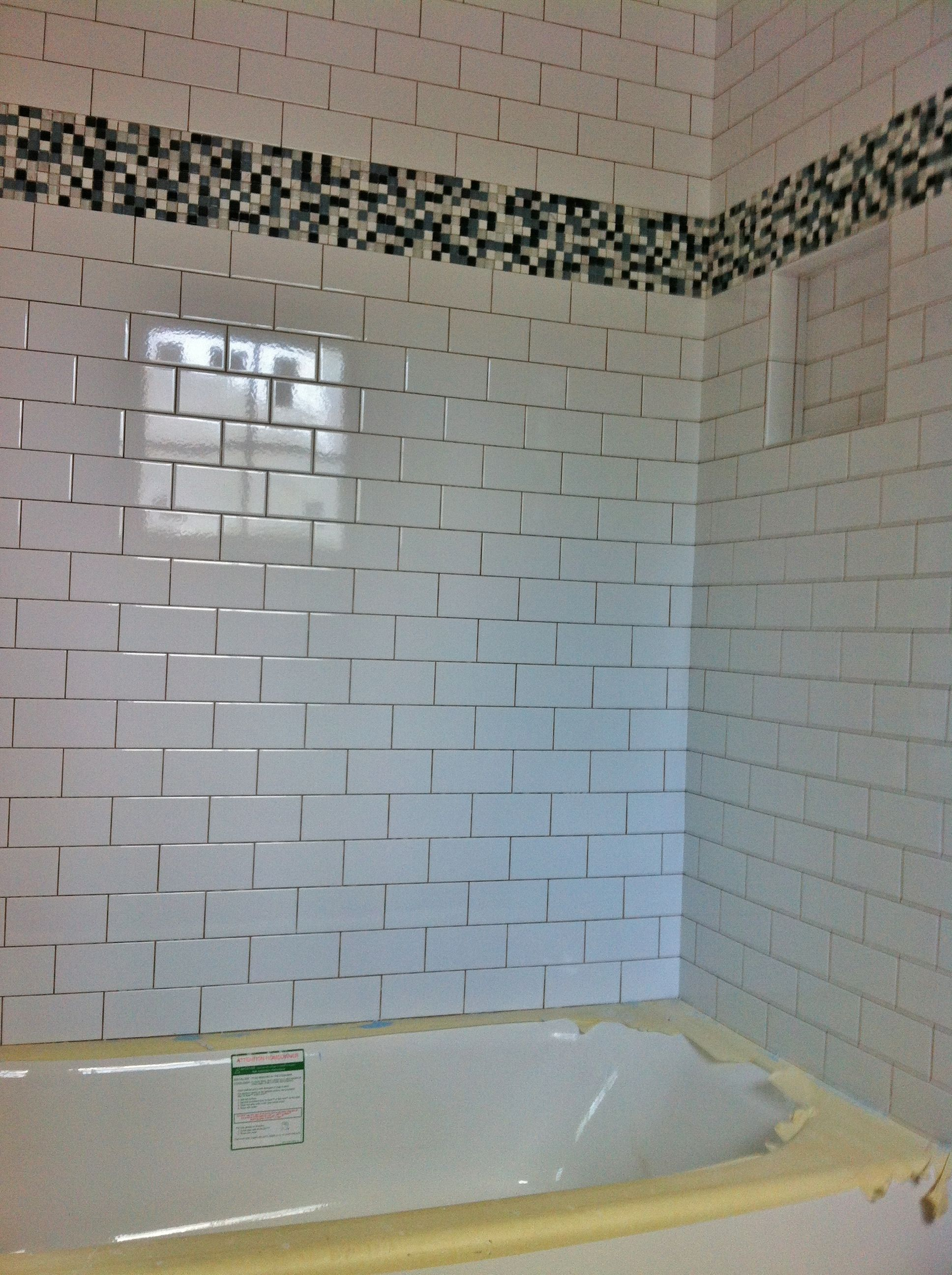 3x6 white porcelain subway tile with glass and stone accent at tub ...