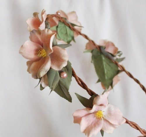 Here's the flower crown that I'm thinking of wearing for the wedding as a veil alternative.=)