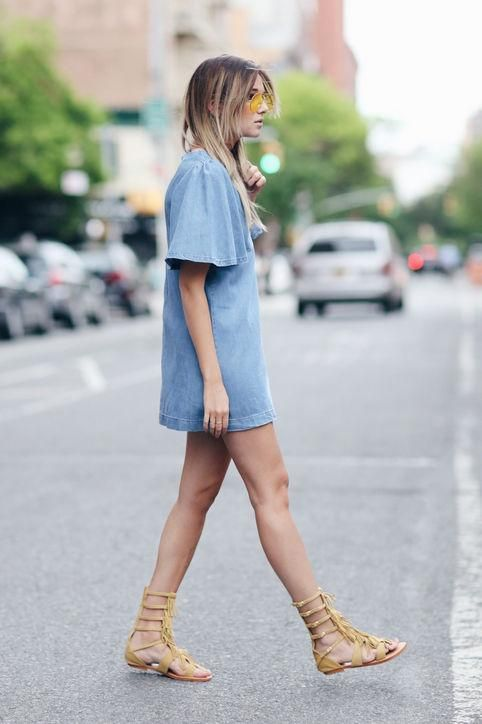 4th of July outfit idea: We Wore What in a denim mini dress and gladiator sandals