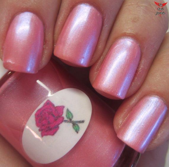 A pink pastel shimmer polish with blue undertones that dries to a powdery finish