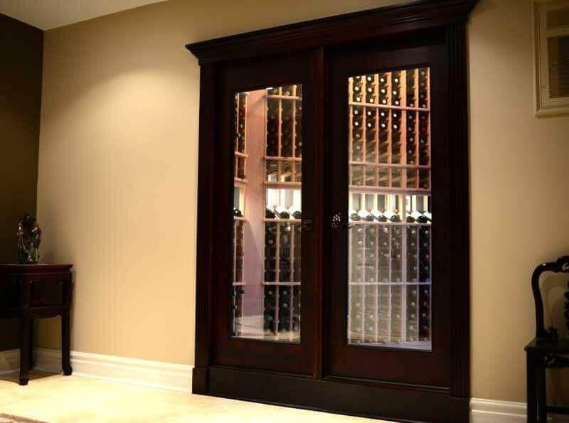 Vigilant french glass door entrance into small wine room located in house vigilant french glass door planetlyrics Image collections