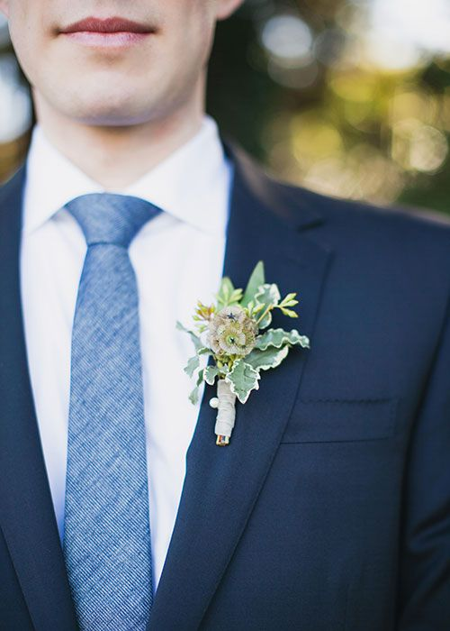 Groom's Navy Blue Suit with Greenery Boutonniere | Brides.com