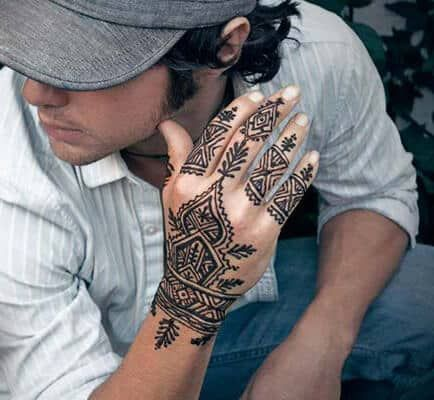 Henna Tattoos for Men is part of Men henna tattoo, Tribal henna designs, Henna designs hand, Henna men, Henna, Tattoo designs - One of the biggest factors that hold back men from getting a tattoo is the permanent nature of said tattoos  Also, there is very little room for modification or experimentation and one has to pretty…
