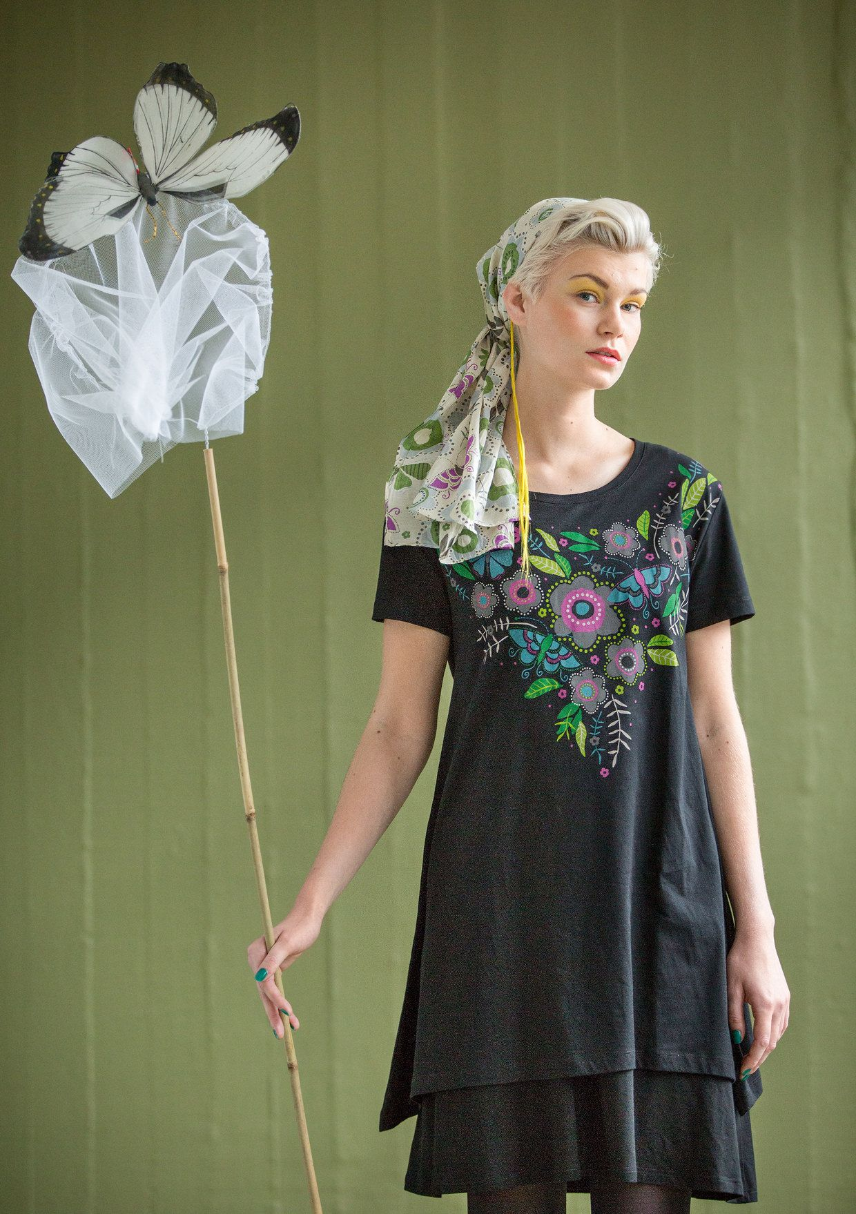 Flared tunic with lush flowers and fluttering butterflies printed in front around the neckline. Lightweight organic cotton jersey style with short sleeves and longer sides.