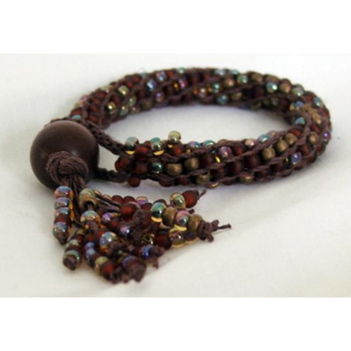 Beautiful kumihimo bracelet jewlery pinterest bracelets beads a lovely chunky beaded kumihimo bracelet made using natural hemp threads and complementary size 6 seed beads in browns and golds with a tasselled finish fandeluxe Images