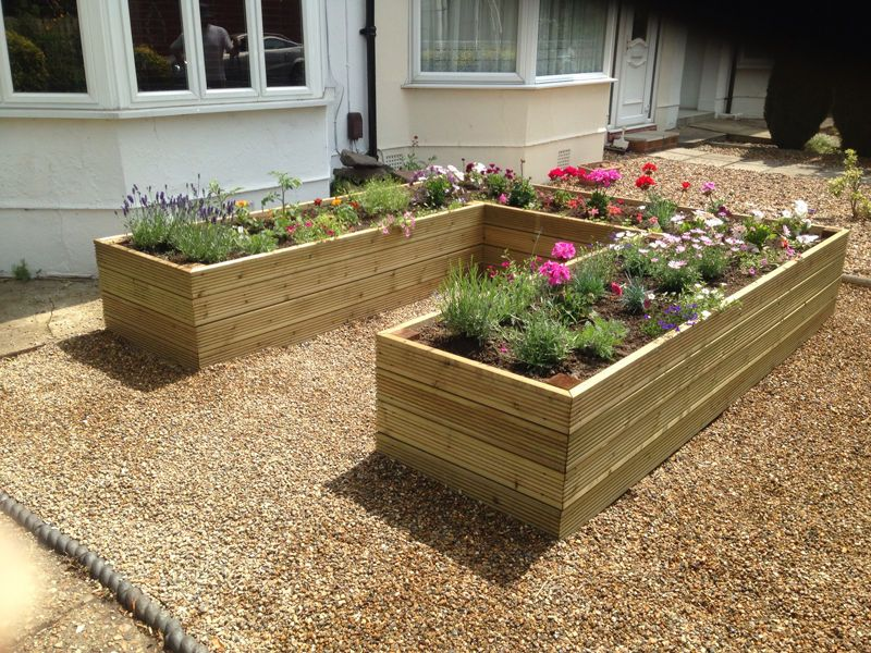 Pressure treated decking raised bed vegetable garden for Raised border edging