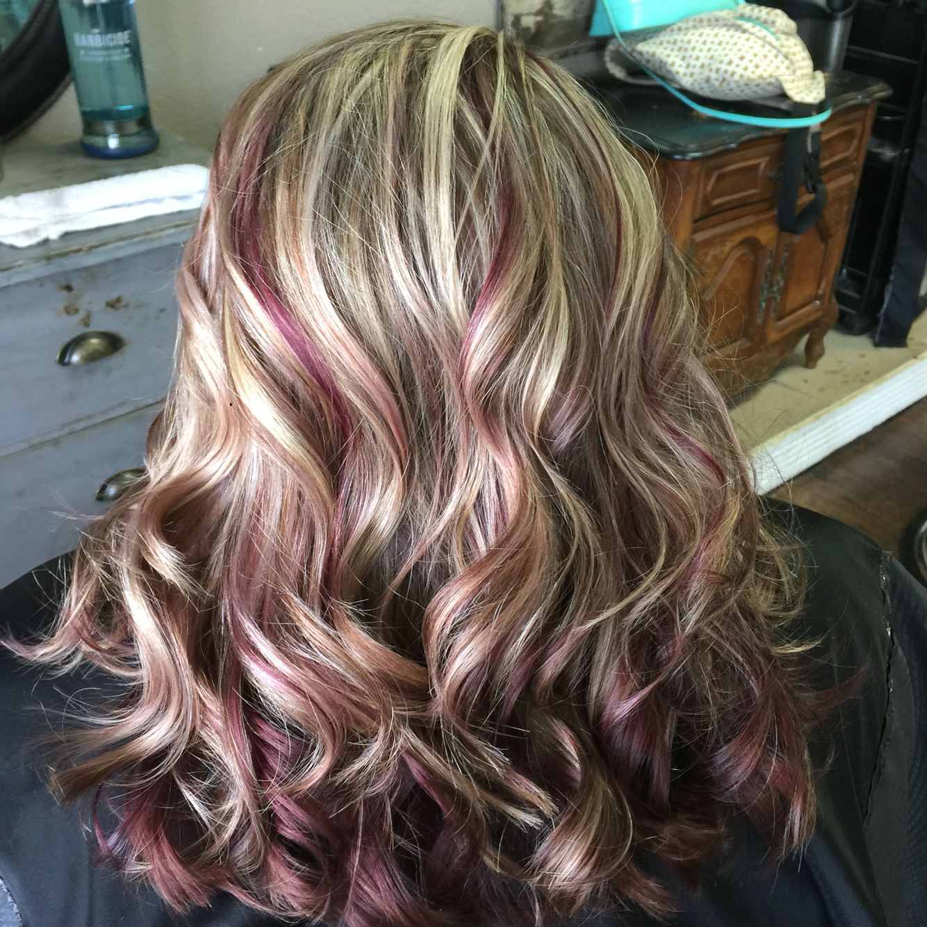 Love my hair violet red underneath with highlights as well as brown