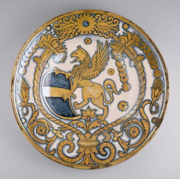 Dish with Coat of Arms of Bishop Baglioni, Deruta, Italy, ca. 1500-1530, earthenware with tin glaze (maiolica) and luster decoration, 8.5 x 42 cm, The Walters Art Museum 48.1336
