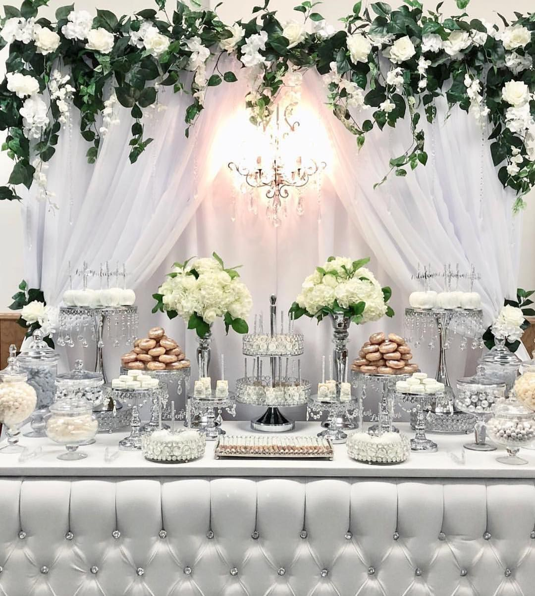 Tbt To This Beautiful White And Silver Candy Dessert Table By Bizziebeecreations Minidonuts Fl Wedding Candy Table Wedding Cake Backdrop Dessert Table Decor