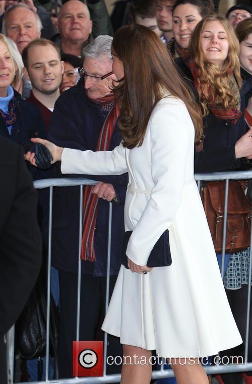 Kate in white swing coat