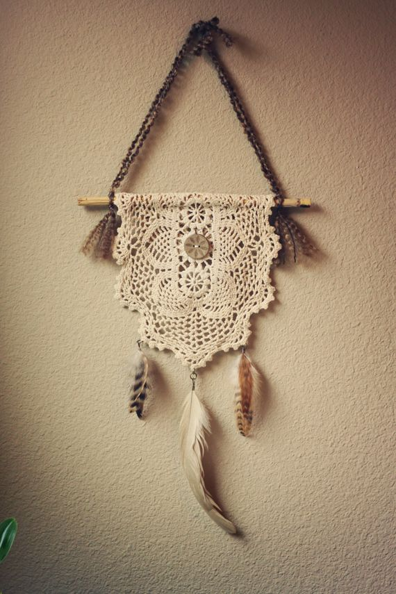 Gypsy inspired nontraditional dream catcher using a doily, a rustic button, and feathers (stones if desired), hung on a stick.
