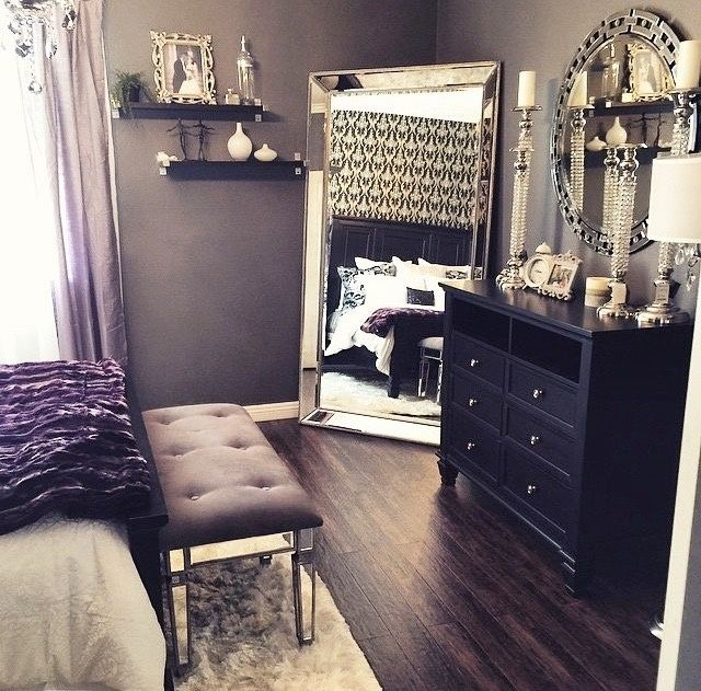 Love everything of this bedroom... the gray wall color, the floor mirror, the shelves on wall, and the black dresser